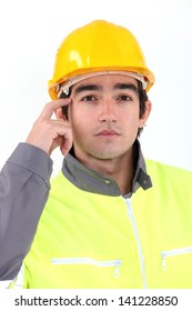 Traffic guard scratching his head