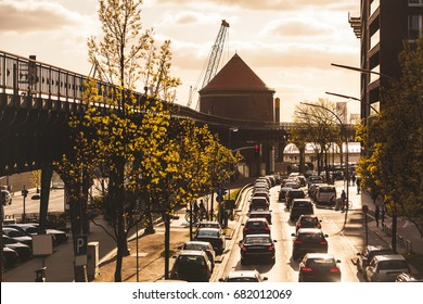 Traffic in Hamburg at sunset. Aerial view of a busy streets with cars, elevated railway on the left. Transport and travel concepts. Warm color filter added on purpose for the mood