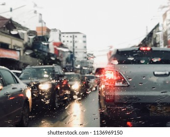 Traffic jam because of heavy rain fall. Urban life, vintage tone