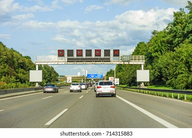 traffic jam - cars braking - sign bridge on freeway, german autobahn