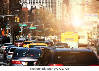 Traffic jam with cars crowding 1st Avenue during rush hour in New York City with sunlight shining in the background