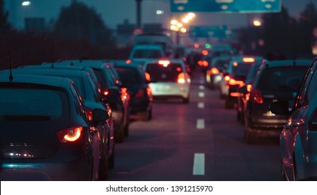 Traffic jam cars in row dusk night