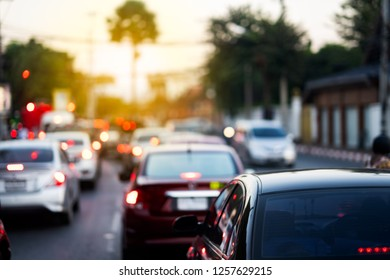 Traffic jam city concept, many cars stop on corner and working time on Blurred view of transportation  traffic jam on city