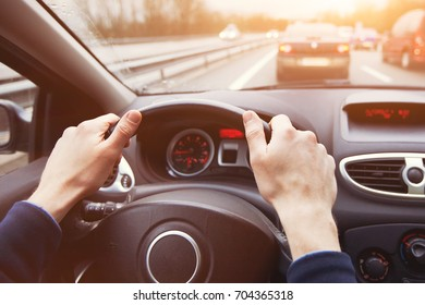 traffic jam, driving car on highway, close up of hands on steering wheel in sunny day