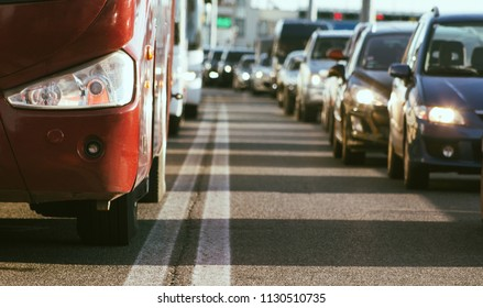 Traffic jam on busy road vehicles waiting in row