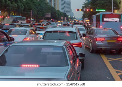 traffic jam on main street with row of cars in downtown, central businees distric