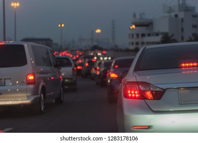 traffic jam on main street with row of cars in downtown, central businees distric before night