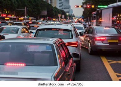 traffic jam on main street with row of cars in downtown, central business distric