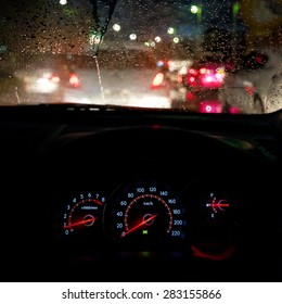 A traffic jam in a rainy season, View from car seat.