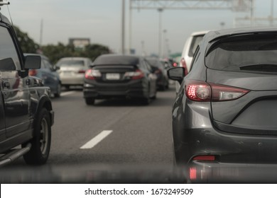 traffic jam with row of cars on road, rush hour