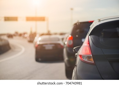 traffic jam with row of cars on toll way, rush hour
