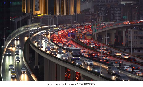 Traffic jam in the rush hour on highway. Cars on bridges and roads in Shanghai Downtown, China at night.