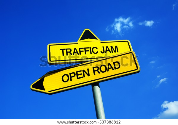 Traffic Jam vs Open Road - Traffic sign with two options - heavy and problematic traffic on the road vs light and smooth transportation with car on motorway and highway. Rush hour vs empty ways