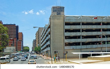 Traffic in Johannesburg. Parking. Cars. Modern buildings in South Africa. People walking along the streets. Transportation. Johannesburg, South Africa - December 21, 2013
