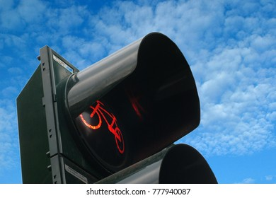 Traffic light for bicycles with blue sky background