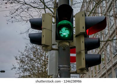 "traffic light in Bremen, Germany shows ""green"" for pedestrians with a shape of Santa Claus"