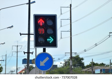 Traffic light at the crossroads in Thailand, red for stop and green for turn right