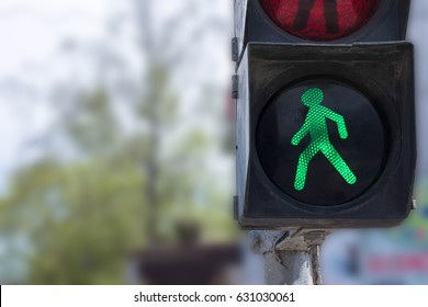 A traffic light with a green little man. Safety on the roads. Life insurance.