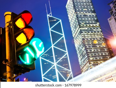 Traffic light in the modern city at night, hong kong.