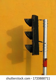 Traffic light in the old city center of George Town Penang, on a yellow background, George Town Penang, Malaysia, ASIA.