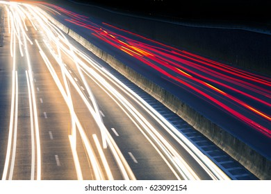 Traffic light on night highway