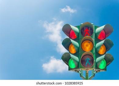 Traffic light on the sky background