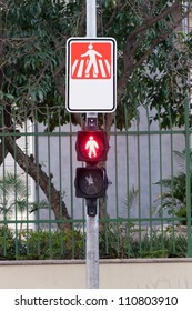 traffic light for pedestrians indicating stop with the red light