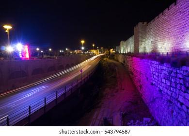 traffic light streaks besides Jerusalem old city wall
