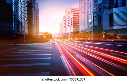 Traffic light trail in between building