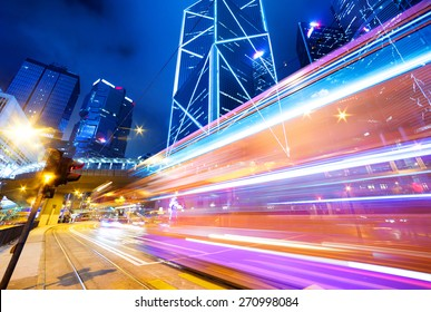 traffic light trails and buildings in modern city