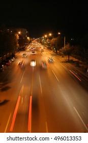 traffic light trails and modern street