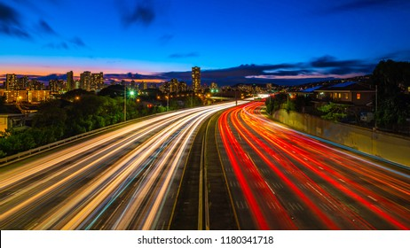 traffic light trails from an overpass over a busy city highway in Honolulu Hawaii Oahu