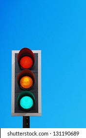 traffic lights against a vibrant blue sky (copy-space ready for your design)