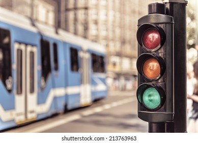 Traffic lights and city tram in Krakow, Poland.
