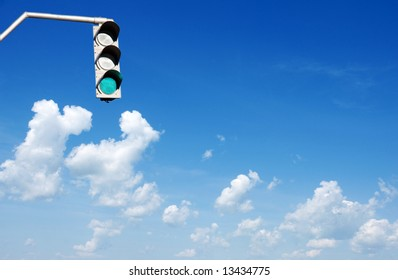 Traffic lights in front of blue sky