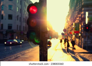 Traffic lights at night outdoors at sunset. Riga, Latvia