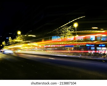 Traffic lights at night, shoot at low speed to get that blurred and trail effect. It's intentionally blurred to get the speed light effect