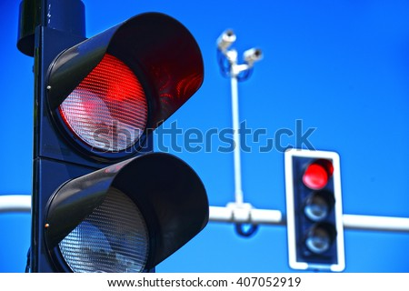 Traffic lights over blue sky.