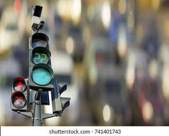 Traffic lights with radar and speed camera. Pedestrian and vehicular traffic on the background traffic.
