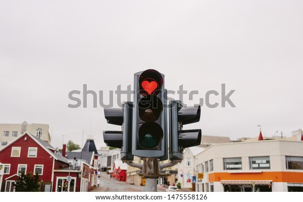 A traffic lights with red hearth in Akureyri city. Iceland. Sign of love