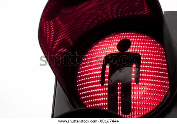 Traffic lights with the red light lit.