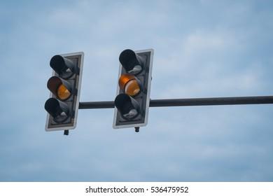 Traffic lights. View of a traffic lights - orange lit