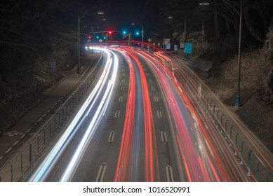 Traffic at night, long exposure light trails on highway through
