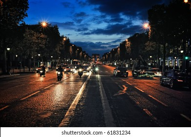 Traffic on the avenue Champs-Elysee at evening