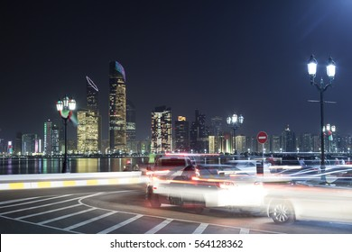 Traffic on the corniche of Abu Dhabi at night. United Arab Emirates, Middle East