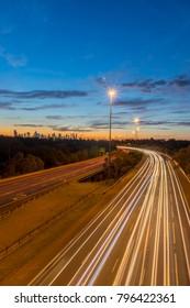 Traffic on the Eastern Freeway at dusk, passing through Yarra Bend Park, as seen from the Yarra Boulevard bridge in Kew.
