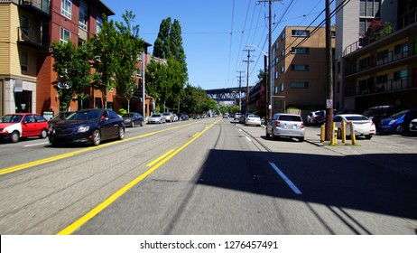 Traffic on Eastlake Avenue heading to underpass of Interstate 5 bridge in Seattle, Washington