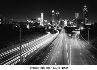 Traffic on Freedom Parkway and the Atlanta skyline at night, seen from the Jackson Street Bridge in Atlanta, Georgia.