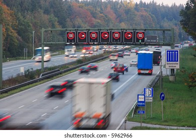 traffic on german autobahn with speed limit sign, motion blur