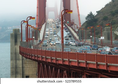 Traffic on Golden Gate Bridge in the evening with foggy